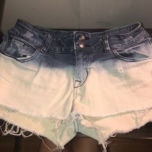 Dip dyed ombré blue to white jean shorts